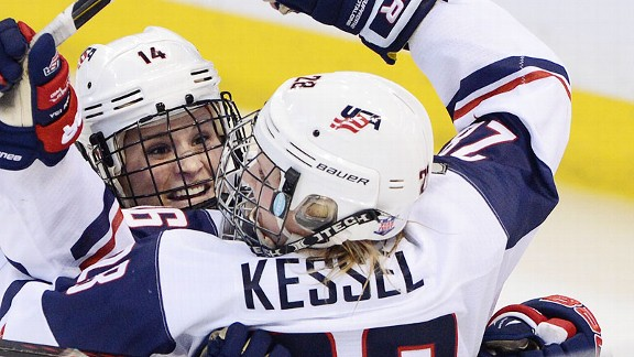 Brianna Decker races to congratulate Amanda Kessel on Kessel's go-ahead goal in the third period.