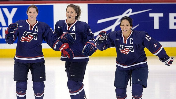 Kacey Bellamy, left, Meghan Duggan, center, and Julie Chu helped bring home the gold from Canada.