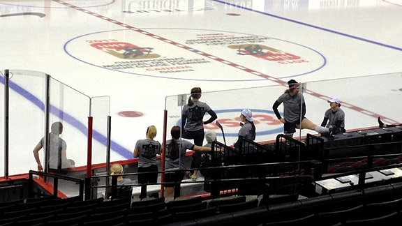 Here we are, hanging around before off-ice warm-ups during an early game. A few players attempted penguin-belly-slide races on the ice to see how far they could slide past the blue line.