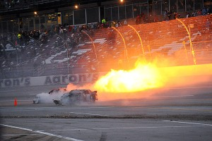 Alex Bowman's car catches on fire after crashing on the final lap of the Nationwide race at Talladega Superspeedway.