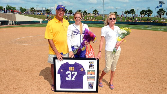 Rachele Fico with her parents, Ralph and Lee, on Senior Day in Baton Rouge. Ralph travels from Connecticut to see Rachele pitch as often as possible despite his illness.
