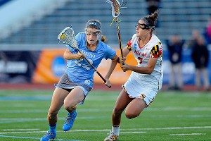North Carolina Tar Heels midfielder Emily Garrity, left, manuevers around Maryland's Katie Schwarzmann.