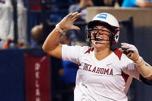 Oklahoma's Lauren Chamberlain heads for home after her two-run blast in the 12th won Game 1.