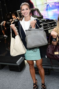 Alex Morgan checks out some purses during New York fashion week.
