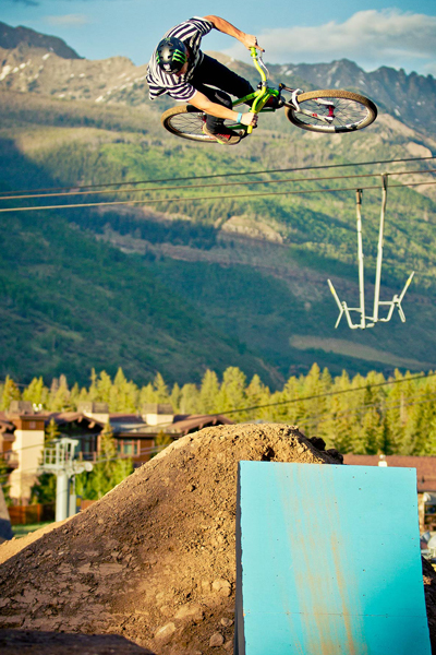Sam Pilgrim works the hip jump with the Gore Range in the background at the 2012 Mountain Games in Vail, Colo.