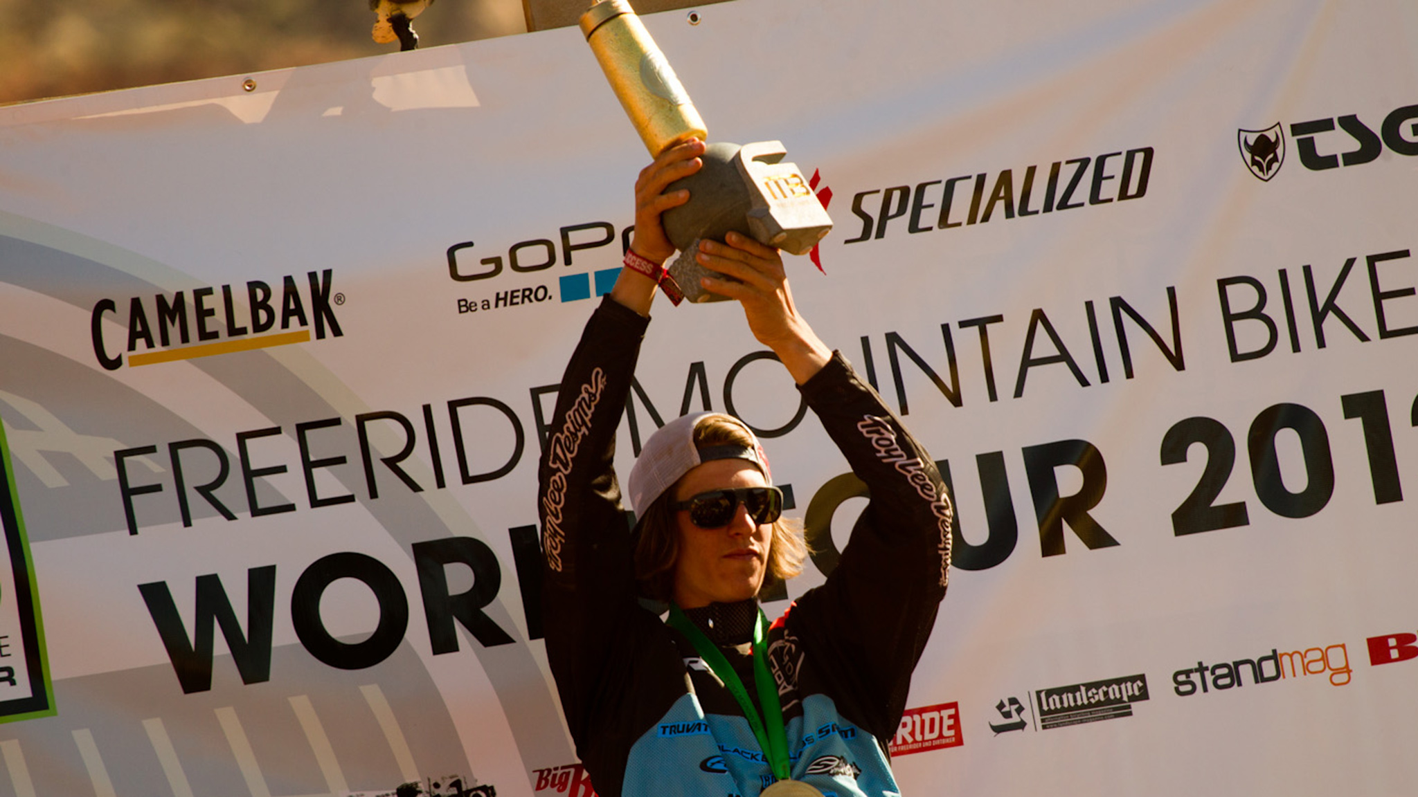 Canadian Brandon Semenuk holds the 2012 Freeride Mountain Bike World Tour season champion's trophy aloft after holding off Martin Soderstrom in the last event of the season, the Red Bull Rampage.