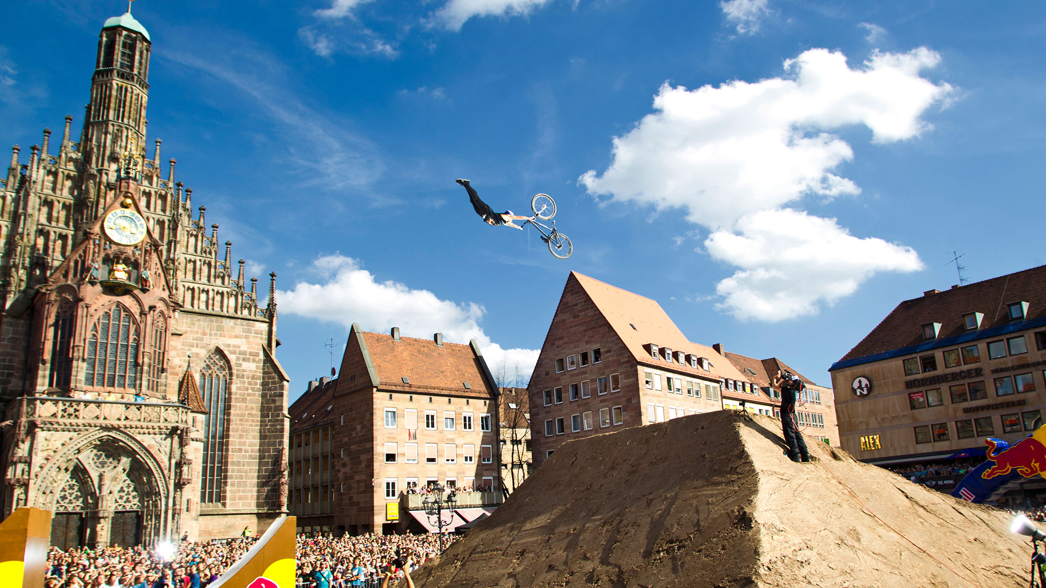 Andreu Lacondeguy does a massive Superman at the Red Bull District Ride in Nuremberg, Germany. He is one of 16 athletes in Munich to compete for the first-ever X Games gold medal in Mountain Bike Slopestyle.