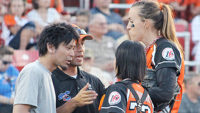 The usual pitcher-catcher battery doubles in size when you account for translator Masashi Takano, head coach Michael Steuerwald, pitcher Monica Abbott and catcher Kazuki Watanabe.