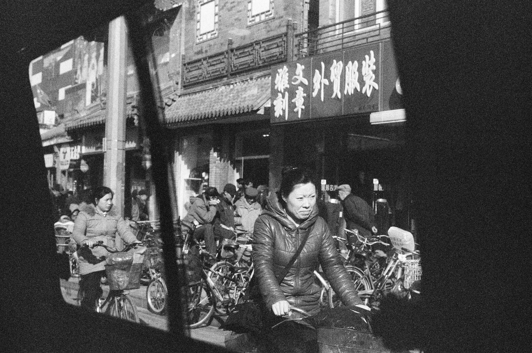 Lady on a bike, Beijing, China