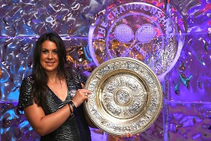 Marion Bartoli, posing with the Venus Rosewater Dish trophy at the Wimbledon 2013 Winners Ball, won her first Grand Slam title at the All England Club on Saturday.