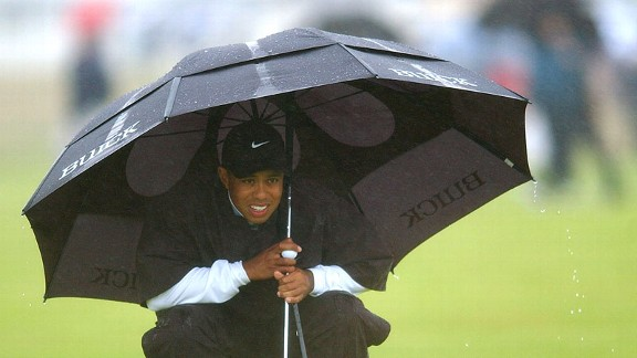 The wind and the rain and the cold were more than Woods and the field could handle on that Saturday at Muirfield in '02.