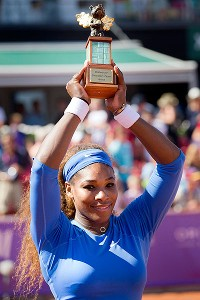 Serena Williams exults after taking her 53rd WTA title Sunday, beating Johanna Larsson in straight sets.