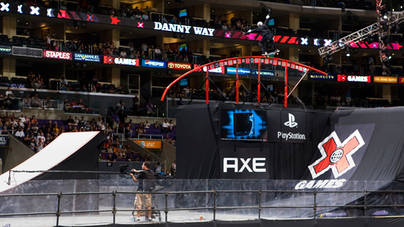 Danny Way does a 5-0 over the mega rainbow rail in the Big Air Rail Jam at X Games L.A. in 2009.