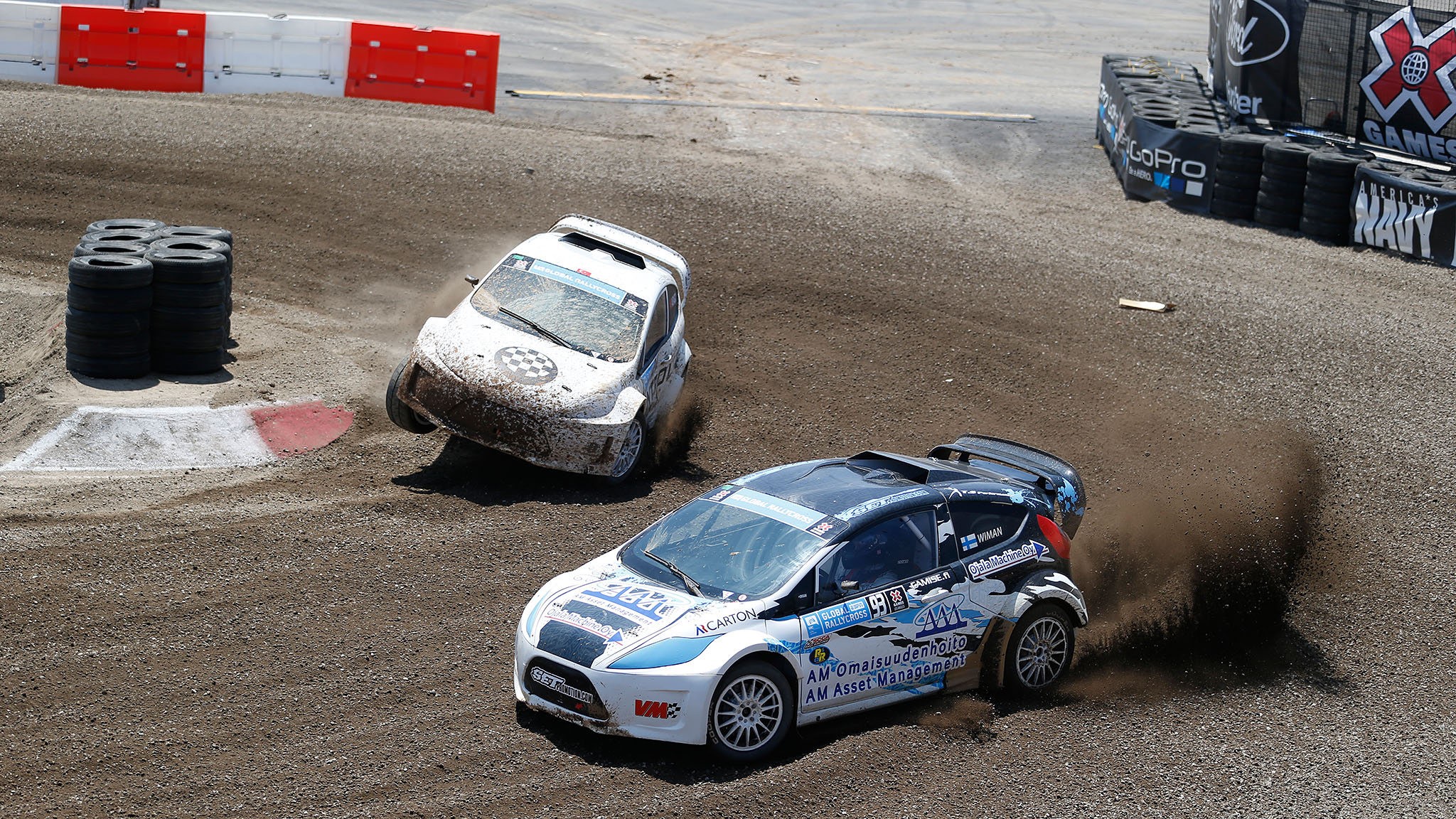 Joni Wiman laps Halid Avdagic en route to winning a gold medal Sunday in the first RallyCross Lites final in X Games history, held at the Irwindale Speedway. Avdagic finished seventh in the eight-car main event.