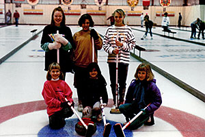 Cassie Potter, left in front row, and her sister Jamie, right in front row, grew up spending their Sunday nights at the local curling arena and went on to become 2006 Olympians.