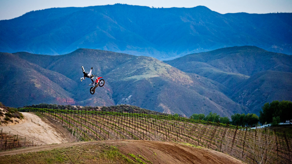 When you've got 50 acres to play with, a private FMX compound doesn't seem so odd an addition. Jimmy Fitzpatrick, one-handed Indian air seat grab over the 130-foot gap at Fitzland.