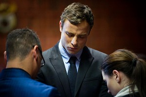 Oscar Pistorius cries as he prays with his sister Aimee and brother Carl prior to his indictment Monday.