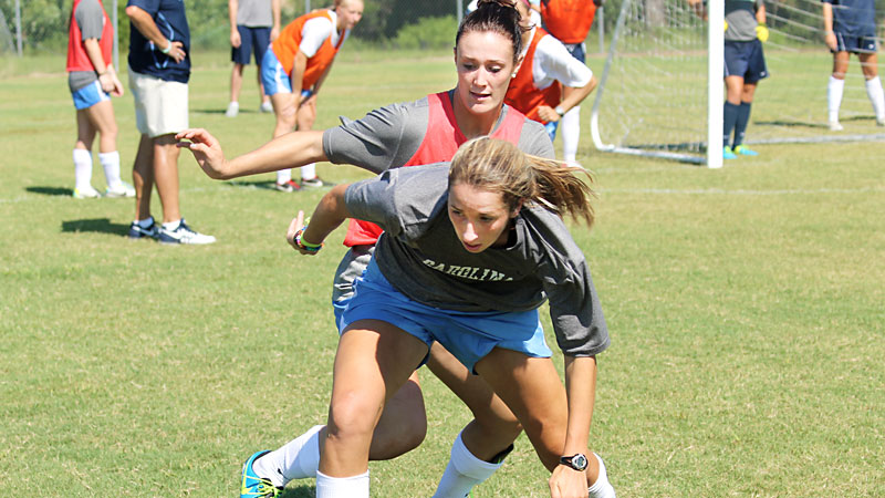 Kelly McFarlane, front, and freshman Maggie Bill play against each other during practice as hard as they'll play for each other during a game.