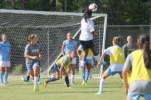 UNC defender Satara Murray rises for a header during practice at a high school near Ocean Isle Beach. Following the philosophy of Dutch coach Raymond Verheijen, practices are short and intense.
