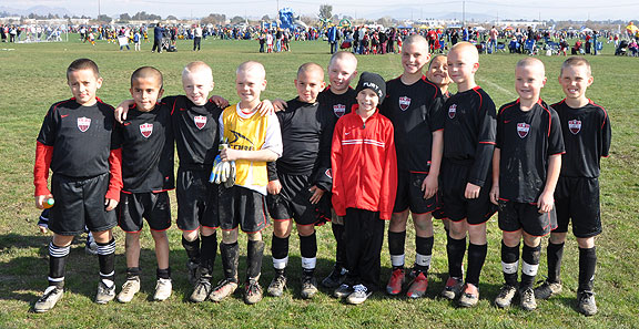 The Fallbrook Fury -- the team Chris played for when he was injured by the ball. They all shaved their heads in support of him.