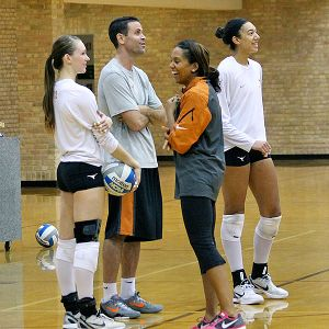 Salima Rockwell shares a light moment at practice with Hannah Allison, left, assistant coach Erik Sullivan and Haley Eckerman.