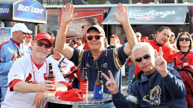 Cardinals fan Ed Obermark, left, and Rams fans Jerry Ortinall, center, and Herman Wolinski must have been drowning in their beers after both St. Louis teams last Monday night.
