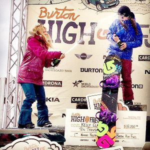 Gretchen Bleiler sprays celebratory champagne on pal Kelly Clark, after Clark's win at the Burton High Fives Open.