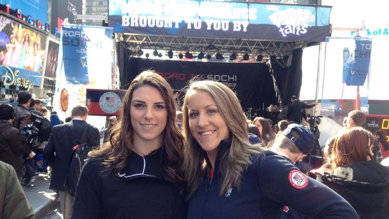 Times Square became an Olympic playground to mark 100 days until the Sochi Games for hockey teammates Meghan Duggan, right, and Hilary Knight.