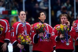 Geraldine Heaney, left, and her Canadian teammates weren't in the mood to celebrate their silver medals after they lost the gold to the U.S. in 1998, the first time the Winter Olympics included women's hockey.