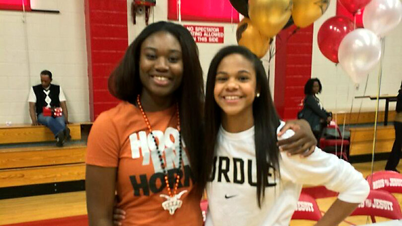 Regis Jesuit (Aurora, Colo.) stars Diani Akigbogun (Texas) and Justine Hall (Purdue) signed on the dotted line at a ceremony on Wednesday. Our fans will love her attitude and work ethic, Longhorns coach Karen Aston said of Akigbogun, a 6-foot, three-star forward. Purdue coach Sharon Versyp had praise for Hall, the No. 74 prospect in the espnW HoopGurlz Top 100.  Justine is an explosive player with a long, wiry frame and will be able to help us in a variety of ways, Versyp said. I(Photo Courtesy Regis Jesuit athletics)/I