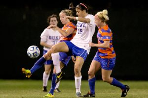 Kim DeCesare had both goals in regulation for unlikely quarterfinalist Duke in its third-round win over Arkansas in a penalty shootout.