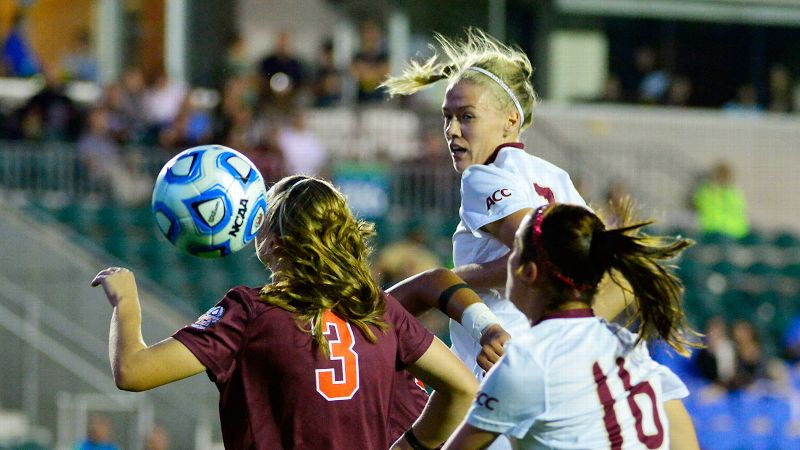 Florida State's Dagny Brynjarsdottir (rear) heads the ball through the Virginia Tech defense during Friday's semifinal game.