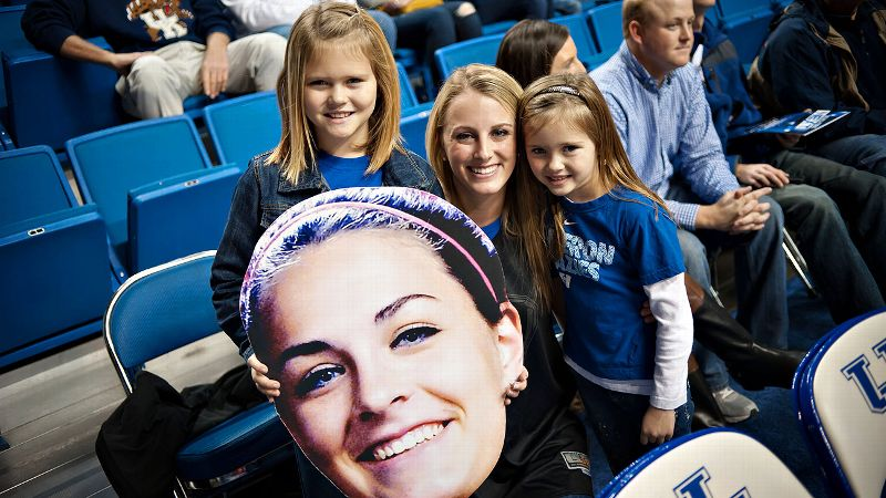 Becca Greenwell's Fathead hung out with her fan club, sisters (from left) Briley Elder, Rachel Greenwell and Emma Elder, during Sunday's game at Kentucky.
