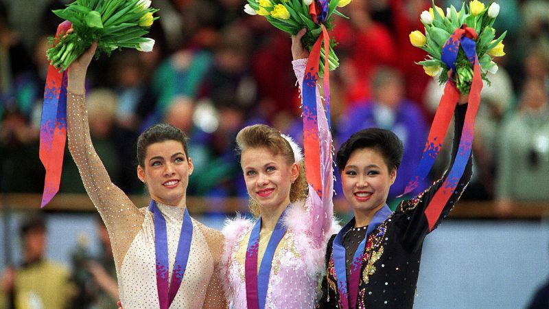 Oksana Baiul, center, became the it girl of the 1994 Olympics after winning the gold medal in figure skating despite sustaining an injury that required stiches while practicing ahead of the long program. The 16-year-old Ukrainian defeated sentimental favorite Nancy Kerrigan for the top spot in one of the closest contests in figure skating history. After completing the post-Olympic media rounds, Bauil moved to the United States to continue training. However, due to chronic injuries and problems with alcohol, she never returned to competitive skating. She has appeared with various skating tours, including Broadway on Ice and developed her own clothing and jewelry line. She is currently embroiled in a legal battle with NBC over the use of her name to promote skating shows. (Photo: Mike Powell/ALLSPORT)