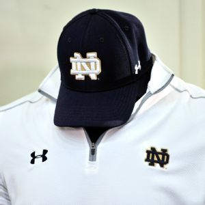 Notre Dame and Under Armour have agreed to a 10-year deal worth 90 million in cash and merchandise combined, according to sources, that makes it the richest shoe and apparel deal in college sports.