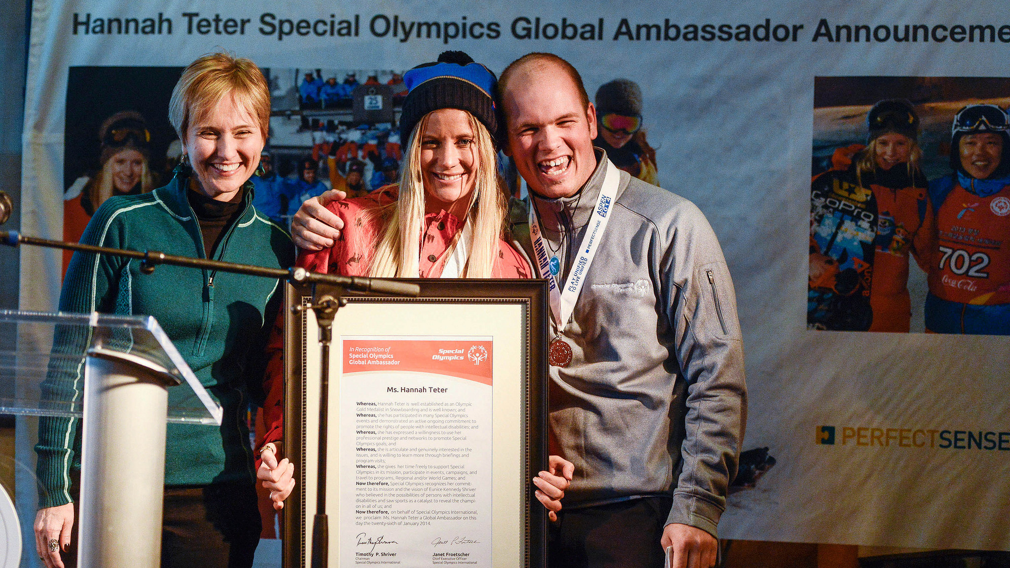 Hannah Teter is presented with her Special Olympics Global Ambassador proclamation by Special Olympics International CEO Janet Froetscher (left), and her Unified partner Special Olympics Colorado athlete Cody Field (right).