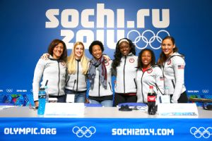 Lolo Jones, far right, and her Olympic bobsled teammates were all smiles at a news conference in Sochi on Monday.