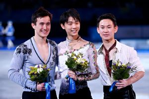 Yuzuru Hanyu took the gold medal in men's figure skating, with Patrick Chan, left, winning silver, and Denis Ten the bronze.