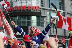 Canadian fans celebrated the hockey gold medal by shutting down the intersection at Yonge-Dundas Square in Toronto on Sunday.