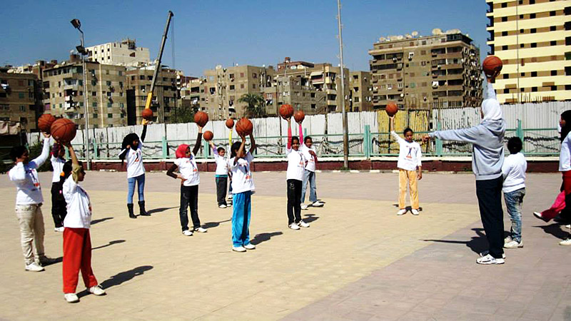 Hayam Essam conducts an after-school basketball session with girls in her Girl Power program.