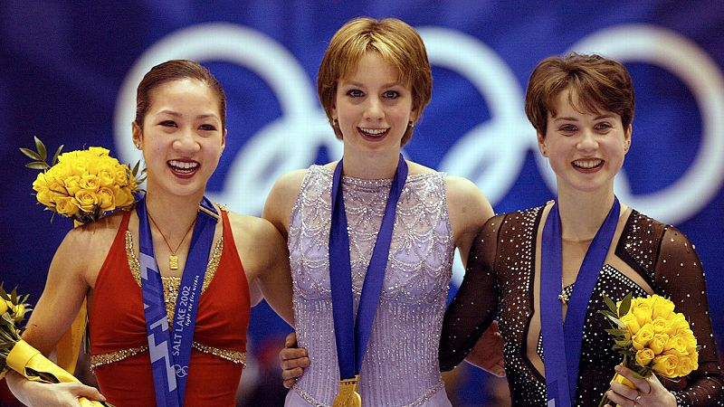 After being narrowly defeated by Tara Lipinski at the 1998 Olympics, the beloved Michelle Kwan entered the 2002 Games in Salt Lake City as a favorite to claim gold. An estimated 43 million fans watched Kwan ... falter again to another American teen. Sixteen-year-old Sarah Hughes skated a near flawless free program to jump from fourth place to first and pull off one of the biggest upsets in figure skating history. Kwan finished with the bronze medal, behind Russia's Irina Slutskaya.