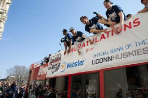 UConn players celebrate during Sunday's downtown Hartford victory parade for the national championships won by the men's and women's basketball teams.