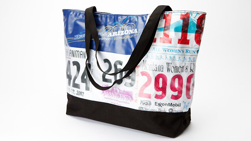 You have a drawer full of race bibs and medals from racing career. Why not recycle them and show off your accomplishments with a custom bag? Your race memorabilia -- race bibs, T-shirts and photos -- are sewn to the exterior of the bag and then covered with vinyl to protect it. You can even use your medal for a zipper pull. Bags typically take three to four weeks.