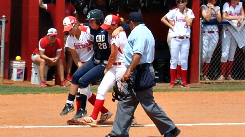 Florida Southern's Leah Pemberton (left) and Chelsea Oglevie (right) carry Eckerd's Kara Oberer to home plate after the home run.