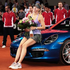 After losing the first set, Maria Sharapova won the next two against Ana Ivanovic to win the Porsche Grand Prix for her 30th singles title of her career.