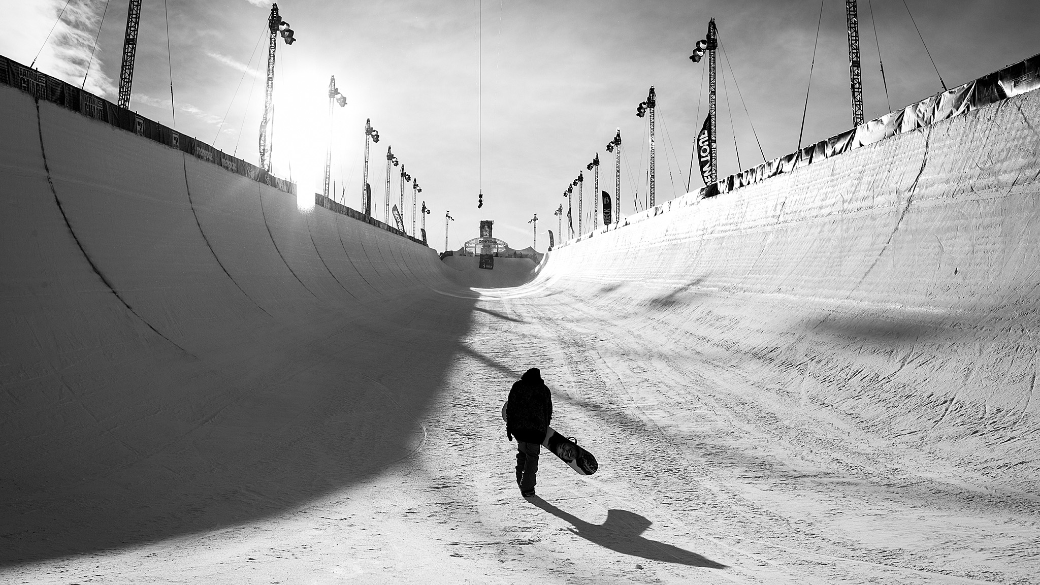 Danny Davis takes a lone hike up the middle of the pipe in Breckenridge after the first Dew Tour and Olympic qualifiers. That day was the start of an amazing season for Danny, says photographer Adam Moran. After the event, he held back to ride a little more in the evening light.brbrAnd after that, he went on to set snowboarding on fire with his switch pipe tricks. If competition seasons had MVPs, Danny Davis might be it this year.