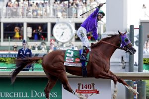 California Chrome, ridden by jockey Victor Espinoza, pulled away to win the 140th Kentucky Derby.
