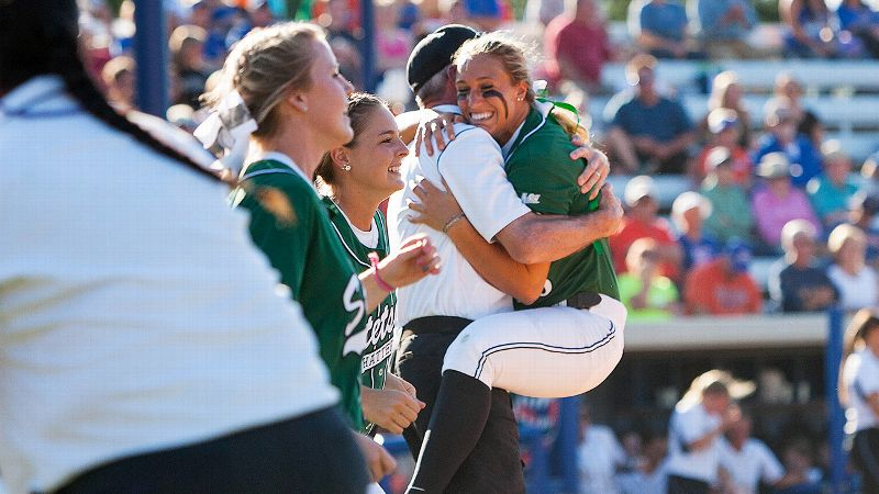 Stetson senior Meredith Owen jumps into the arms of coach Frank Griffin after the Hatters' first tournament win.