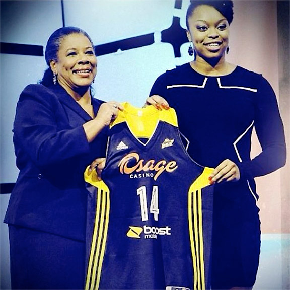 Me and WNBA president Laurel Richie holding my Shock jersey on stage after my name was called.