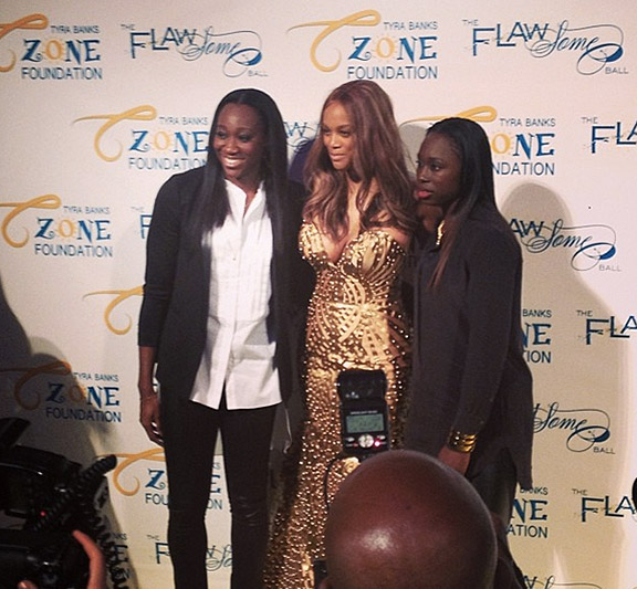 Tina Charles and teammate Essence Carson pose with Tyra Banks at the Flawsome Ball.